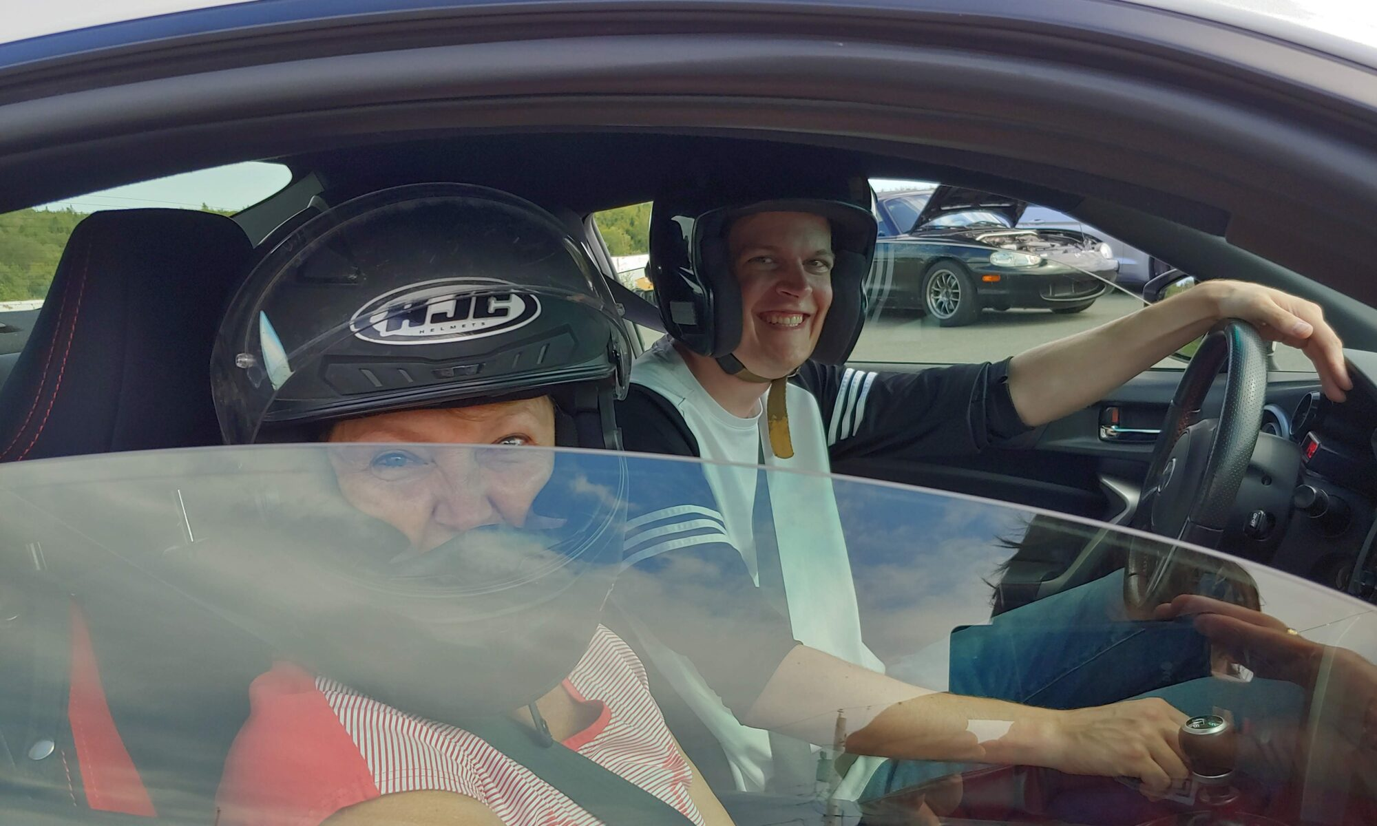 People smiling after driving at AMP